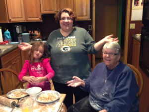 Making cinnamon rolls with my mom and daughter in 2013. It's messy, but worth it!